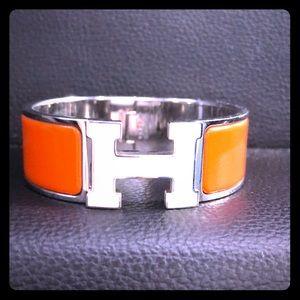 Hermès Orange and White bracelet.